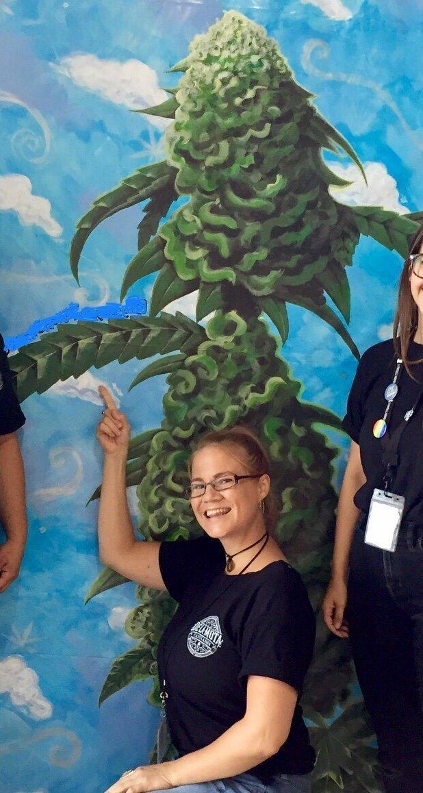 Artist with cannabis mural.
